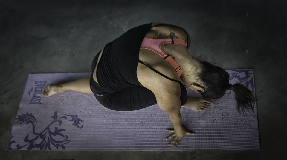 a lady in yoga posture and wearing her yoga attire