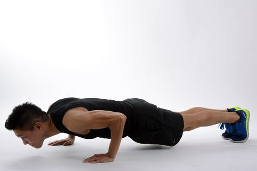 a man doing a classic push ups