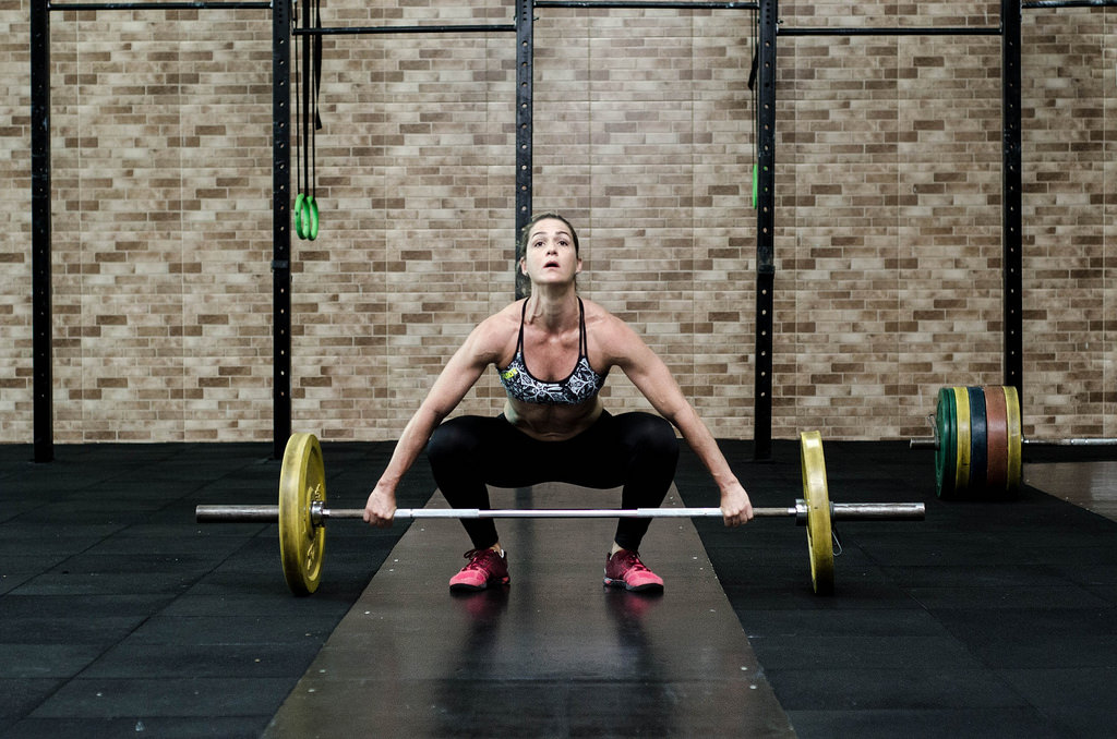 a lady holding a barbell