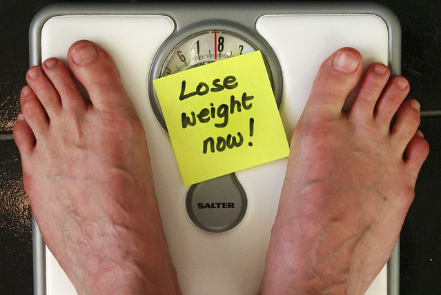 person standing on weighting scale